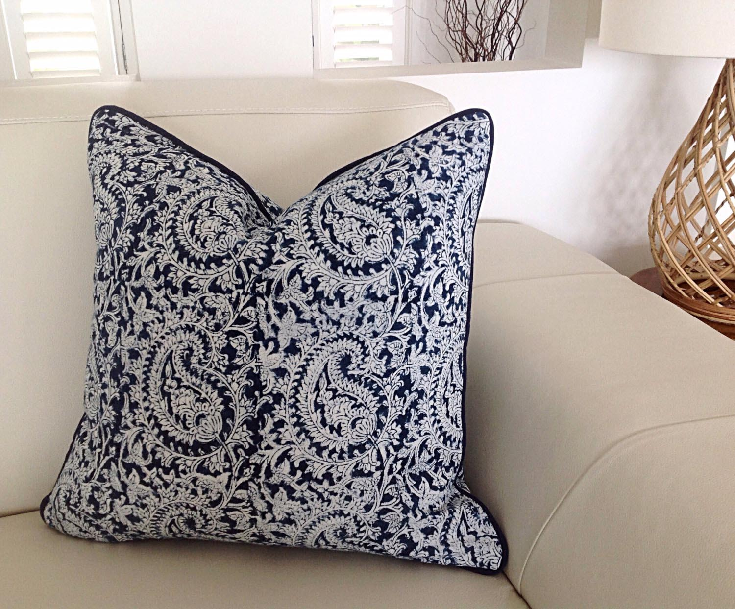 Blue throw pillows, bolsters, lumbar pillows, and breakfast pillows fit well in the living room space. For spaces such as the bedroom where the pillows will be used on the bed, a wide mix of sizes can be used.